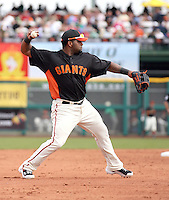 Pablo Sandoval #48 of the San Francisco Giants makes a throw from third base against the Arizona Diamondbacks in the first spring training game of the season at Scottsdale Stadium on February 25, 2011  in Scottsdale, Arizona. .Photo by:  Bill Mitchell/Four Seam Images.