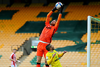 13th February 2021; Carrow Road, Norwich, Norfolk, England, English Football League Championship Football, Norwich versus Stoke City; Angus Gunn of Stoke City collects the ball over Emi Buendia of Norwich City