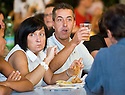 """SAGRA DEL """"PESCE E PATATE"""" 2011, BARGA, ITALY<br /> <br /> VISITORS ENJOY THEIR FISH AND CHIPS."""