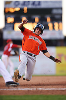 Aberdeen IronBirds right fielder Cole Billingsley (4) slides into third base during a game against the Batavia Muckdogs on July 15, 2016 at Dwyer Stadium in Batavia, New York.  Aberdeen defeated Batavia 4-2.  (Mike Janes/Four Seam Images)