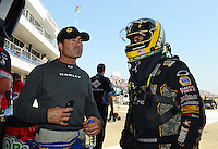 Sept. 22, 2012; Ennis, TX, USA: NHRA top fuel dragster driver Tony Schumacher (right) talks with funny car driver Ron Capps during qualifying for the Fall Nationals at the Texas Motorplex. Mandatory Credit: Mark J. Rebilas-US PRESSWIRE