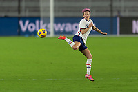 ORLANDO CITY, FL - FEBRUARY 18: Megan Rapinoe #15 flicks the ball during a game between Canada and USWNT at Exploria stadium on February 18, 2021 in Orlando City, Florida.