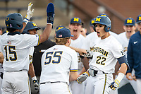 Michigan Wolverines outfielder Tito Flores (22) celebrates after hitting a home run against the Ohio State Buckeyes on April 9, 2021 in NCAA baseball action at Ray Fisher Stadium in Ann Arbor, Michigan. Ohio State beat the Wolverines 7-4. (Andrew Woolley/Four Seam Images)