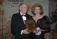 Jan 25, 1989 - Beverly Hills, California, USA - Entertainer Frank Sinatra with his wife Barbara on his side, proudly displays the Will Rogers Award presented him by the Beverly Hills Chamber of Commerce Wednesday night, January 25, 1989, at a star-studded event in Beverly Hills.  The award has been given annually for outstanding contributions to the world of entertainment.  Sinatra has been directly responsible for having raised more than $1 billion for worldwide charity. .(Credit Image: © Alan Greth)
