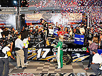 Matt Kenseth, driver of the (17) Crown Royal Black Ford, celebrates after winning the Samsung Mobile 500 Sprint Cup race at Texas Motor Speedway in Fort Worth,Texas.