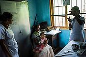 A nurse prepares to vaccinate a child at the local health clinic in Eskdale Tea Estate in Nuwareliya in Central Sri Lanka.  Photo: Sanjit Das/Panos