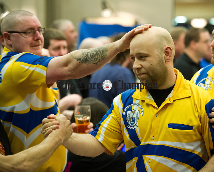 Michael Keating has a word of encouragement for fellow player Pete Andrews following a good performance during the INDO Irish Darts Championships in the West County Hotel. Photograph by John Kelly.