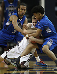 Elko's Cody Nielsen wrestles for a loose ball with Desert Pines' Kevin Butler, left, and Capri Uzan during the NIAA basketball state tournament at Lawlor Events Center, in Reno, Nev., on Friday, Feb. 28, 2014. Elko won 63-47 to advance to the state championship game. (Cathleen Allison/Las Vegas Review-Journal)