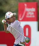 CHON BURI, THAILAND - FEBRUARY 19:  Ai Miyazato of Japan tees off on the 9th hole during day three of the LPGA Thailand at Siam Country Club on February 19, 2011 in Chon Buri, Thailand. Photo by Victor Fraile / The Power of Sport Images