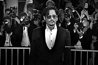 """ENICE, ITALY - SEPTEMBER 06: Johnny Depp walks the red carpet ahead of the """"Waiting For The Barbarians"""" screening during the 76th Venice Film Festival at Sala Grande on September 06, 2019 in Venice, Italy."""
