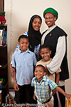 marrried couple in their 30s with sons ages 3, 6, and 8 vertical Muslim American African American