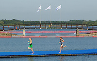 24 JUL 2014 - GLASGOW, GBR - Aileen Reid (NIR) (left) from Northern Ireland leads Nicky Samuels (NZL) (right) from New Zealand from the swim during the elite women's 2014 Commonwealth Games triathlon in Strathclyde Country Park, in Glasgow, Scotland (PHOTO COPYRIGHT © 2014 NIGEL FARROW, ALL RIGHTS RESERVED)<br /> *******************************<br /> COMMONWEALTH GAMES <br /> FEDERATION USAGE <br /> RULES APPLY<br /> *******************************