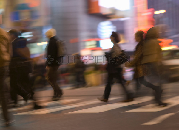 AVAILABLE FROM GETTY IMAGES FOR COMMERCIAL AND EDITORIAL LICENSING.   Please go to www.gettyimages.com and search for image # 135307812.<br /> <br /> Busy, Blurred Motion Scene of Commuters Crossing Street and Heading Home After Work During the Evening Rush Hour, Times Square and 42nd Street, Midtown Manhattan, New York City, New York State, USA