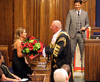 Pictured: Chris Coleman (R) watches on as Lord Mayor for Swansea Councillor David Hopkins gives Charlotte Jackson a bouquet of flowers Thursday 20 October 2016<br />