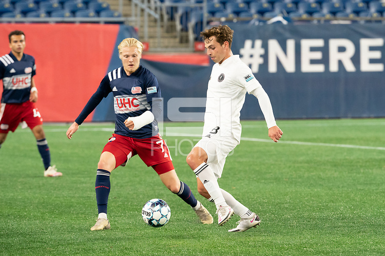 FOXBOROUGH, MA - OCTOBER 09: Blaine Ferri #8 of Fort Lauderdale CF pushes the ball forward as Connor Presley #7 of New England Revolution II comes in to tackle during a game between Fort Lauderdale CF and New England Revolution II at Gillette Stadium on October 09, 2020 in Foxborough, Massachusetts.
