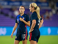 ORLANDO, FL - FEBRUARY 24: Alex Morgan #13 of the USWNT talks with Lindsey Horan during a game between Argentina and USWNT at Exploria Stadium on February 24, 2021 in Orlando, Florida.