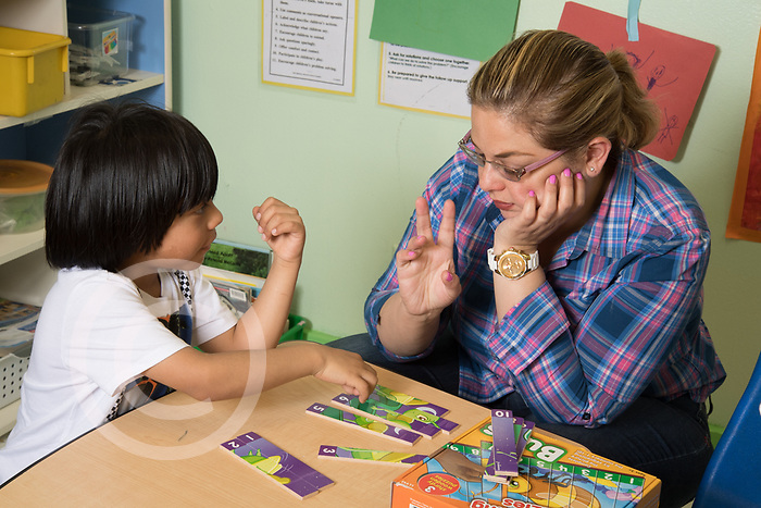 Education Preschool classroom scenes 3-4 years olds SEIT working with boy in classroom