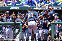 Cal State Fullerton designated hitter Davi Olmedo-Barrera (23) is greeted in the dugout after scoring during the NCAA College baseball World Series against the LSU Tigers on June 16, 2015 at TD Ameritrade Park in Omaha, Nebraska. LSU defeated Fullerton 5-3. (Andrew Woolley/Four Seam Images)