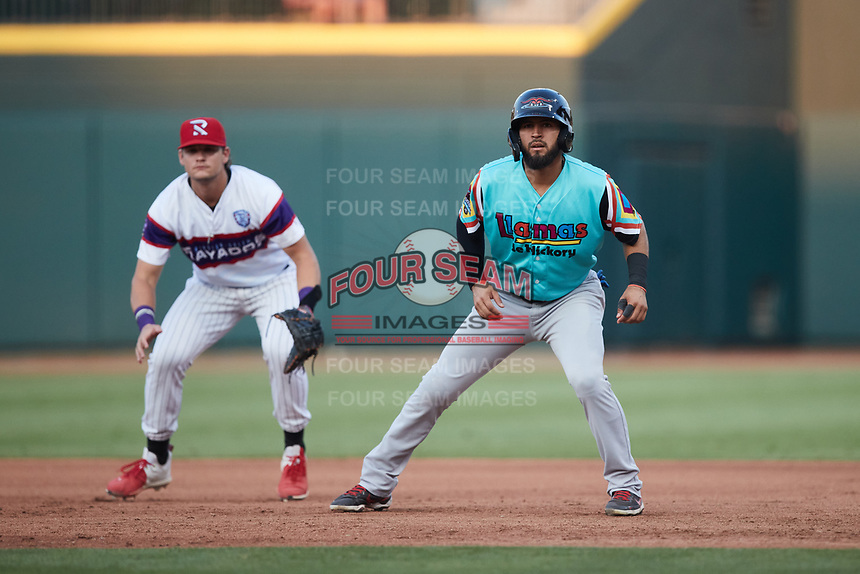 Miguel Aparicio (8) of the Llamas de Hickory takes his lead off of first base against the Winston-Salem Rayados at Truist Stadium on July 6, 2021 in Winston-Salem, North Carolina. (Brian Westerholt/Four Seam Images)