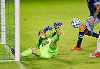 CARSON, CA - OCTOBER 18: Evan Bush #30 GK of the Vancouver Whitecaps attempts to clear a ball from the box during a game between Vancouver Whitecaps and Los Angeles Galaxy at Dignity Heath Sports Park on October 18, 2020 in Carson, California.