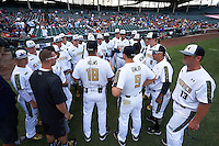 National team meeting with coach Wes Helms (18) and Jim Gemler (9) before the Under Armour All-American Game on August 15, 2015 at Wrigley Field in Chicago, Illinois. (Mike Janes/Four Seam Images)