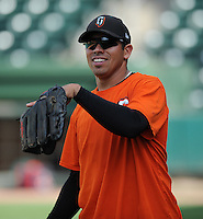 Infielder Juan Martinez (14) of the Augusta GreenJackets, Class A affiliate of the San Francisco Giants, in a game against the Greenville Drive on June 7, 2010, at Fluor Field at the West End in Greenville, S.C. Photo by: Tom Priddy/Four Seam Images