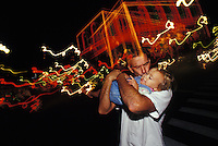 Father kisses daughter near Christmas lights in Downtown Honolulu