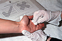Scenes of crime officer swabbing a suspects hand for traces that will show that a firearm has been discharged. The resultant swab will be sent to a police forensic laboratory for detailed analysis. This image may only be used to portray the subject in a positive manner..©shoutpictures.com..john@shoutpictures.com