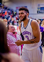 19 January 2019: University of Vermont Catamount Forward Anthony Lamb, a Junior from Toronto, Ontario, smiles as he returns to the locker room at the conclusion of play against the Binghamton University Bearcats at Patrick Gymnasium in Burlington, Vermont. The Catamounts defeated the Bearcats 78-50 to remain unbeaten in conference play to date this season. Mandatory Credit: Ed Wolfstein Photo *** RAW (NEF) Image File Available ***