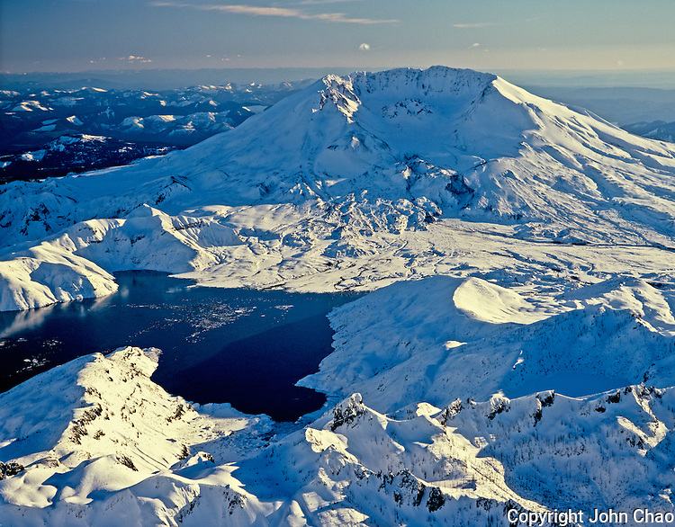 Aerial view of Mount Saint Helens with Spirit Lake in foreground in winter, Washington State.