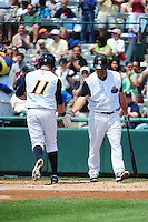 Trenton Thunder outfielder Slade Heathcott (11) hits a home run and is greeted by Kevin Youkillis (36) during game against the Erie SeaWolves at ARM & HAMMER Park on May 29 2013 in Trenton, NJ.  Trenton defeated Erie 3-1.  Tomasso DeRosa/Four Seam Images