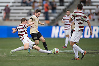 Houston, TX -  Sunday, December 11, 2016: Tanner Beason (3) of the Stanford Cardinal strips the ball from Luis Argued (2) of the Wake Forest Demon Deacons at the  NCAA Men's Soccer Finals at BBVA Compass Stadium.
