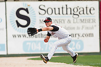 Brady Shoemaker #21 of the Kannapolis Intimidators makes a running catch in foul territory down the left field line during the game against the West Virginia Power at Fieldcrest Cannon Stadium on April 20, 2011 in Kannapolis, North Carolina.   Photo by Brian Westerholt / Four Seam Images
