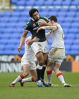 Chris Hala'ufia of London Irish drives through Duncan Taylor of Saracens during the Aviva Premiership match between London Irish and Saracens at the Madejski Stadium on Saturday 9th February 2013 (Photo by Rob Munro)