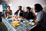 Snow Leopard (Panthera uncia) biologist, Khalil Karimov, conservationist, Tanya Rosen, and ranger, Ulan Toktosunov, and his wife talking over breakfast, Besh Moinok, Tien Shan Mountains, eastern Kyrgyzstan