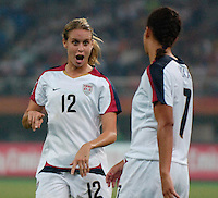 USA midfielder (12) Leslie Osborne talks strategy with midfielder (7) Shannon Boxx. The United States (USA) defeated England (ENG) 3-0 during a quarter-final match of the FIFA Women's World Cup China 2007 at Tianjin Olympics Center Stadium in Tianjin, China, on September 22, 2007.
