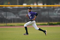 Outfielder Jaime Negron (10) tracks a ground ball during the Perfect Game National Underclass East Showcase on January 23, 2021 at Baseball City in St. Petersburg, Florida.  (Mike Janes/Four Seam Images)