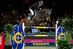 Marc Houtzager of Netherlands riding Baccarat in action during the Laiterie De Montaigu Trophy as part of the Longines Hong Kong Masters on 14 February 2015, at the Asia World Expo, outskirts Hong Kong, China. Photo by Victor Fraile / Power Sport Images