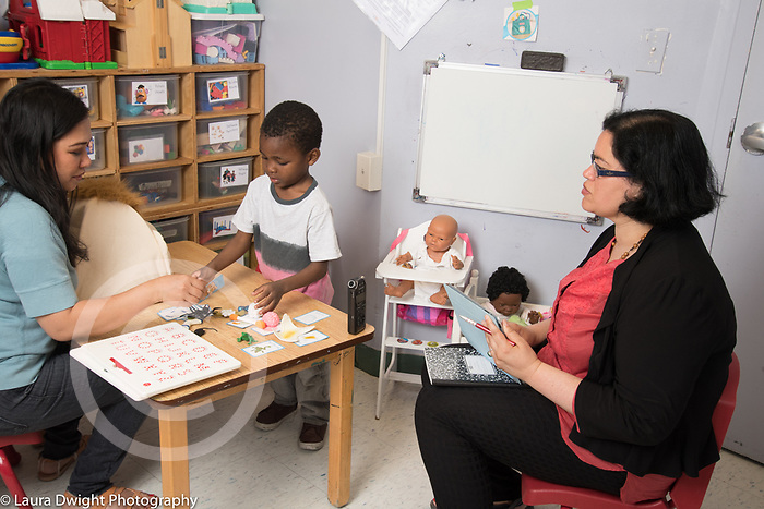 One on one play therapy session, female therapist and 3 year old boy observed by researcher