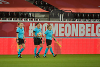 referee Anastasia Pustovoitova (M) with het assistant referees  pictured enetering the pitch of a female soccer game between the national teams of Belgium , called the Red Flames and Switzerland on the 8 th and last matchday in group H for the qualification for the Womens EURO 2022 in England , on Tuesday 1 th of December 2020  in Leuven , Belgium . PHOTO SPORTPIX.BE   SPP   DIRK VUYLSTEKE