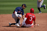 Houston Astros shortstop Jeremy Peña (89) attempts to tag Dylan Carlson (3) sliding back into second base as the ball gets away during a Major League Spring Training game against the St. Louis Cardinals on March 20, 2021 at Roger Dean Stadium in Jupiter, Florida.  (Mike Janes/Four Seam Images)