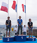 Przemyslaw Miarczynski from Poland (left) Julien Bontemps (center) and Thomas Goyard  (right) from France in the podium during the ISAF Sailing World Championships 2014 at the Real Club Maritimo of Santander on September 19, 2014 in Santander, Spain. Photo by Nacho Cubero / Power Sport Images