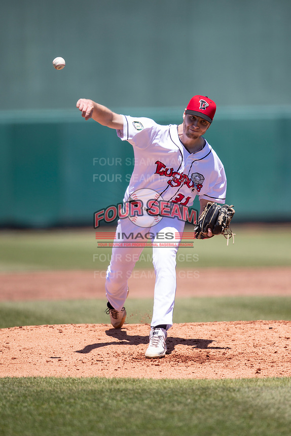 Lansing Lugnuts pitcher Stevie Emanuels (31) delivers a pitch to the plate on May 30, 2021 against the Great Lakes Loons at Jackson Field in Lansing, Michigan. (Andrew Woolley/Four Seam Images)