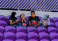 ORLANDO, FL - FEBRUARY 24: A fan reacts after she was given a warm up top by Marta #10 of Brazil before a game between Brazil and Canada at Exploria Stadium on February 24, 2021 in Orlando, Florida.