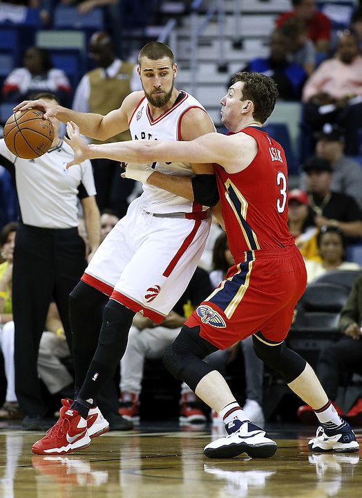 NEW ORLEANS, LA - MARCH 26: Jonas Valanciunas #17 of the Toronto Raptors drives against Omer Asik #3 of the New Orleans Pelicans during a game at the Smoothie King Center on March 26, 2016 in New Orleans, Louisiana. NOTE TO USER: User expressly acknowledges and agrees that, by downloading and or using this photograph, User is consenting to the terms and conditions of the Getty Images License Agreement.  (Photo by Jonathan Bachman/Getty Images)