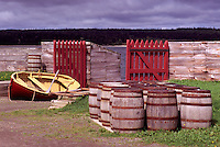 Fortress of Louisbourg National Historic Site (NHS), Cape Breton Island, NS, Nova Scotia, Canada - Barrels and Dory at Waterfront Gate at Reconstructed 18th Century French Fortified Town