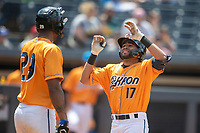 Akron RubberDucks second baseman Marco Gonzalez (17) is greeted at the plate by teammate Will Benson (29) after hitting a home run on June 27, 2021 against the Erie SeaWolves at Canal Park in Akron, Ohio. (Andrew Woolley/Four Seam Images)
