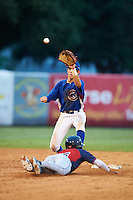 Nolan Jones (22) of Holy Ghost Prep in Langhorne, Pennsylvania catches a throw to tag out Grant Bidson (15) sliding into second while playing for the Chicago Cubs scout team during the East Coast Pro Showcase on July 29, 2015 at George M. Steinbrenner Field in Tampa, Florida.  (Mike Janes/Four Seam Images)