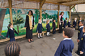 Years 1 & 2 playground singing, St Mary and St Michael Primary School, Stepney, Tower Hamlets, London