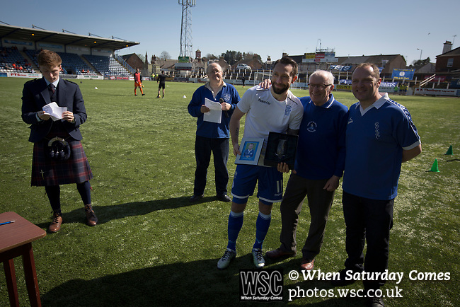 Home team striker Stephen Dobie poses for a photograph on the pitch after receiving an end-of-season award at Palmerston Park, Dumfries before Queen of the South hosted Dundee United in a Scottish Championship fixture. The home has played at the same ground since its formation in 1919. Queens won the match 3-0 watched by a crowd of 1,531 spectators.